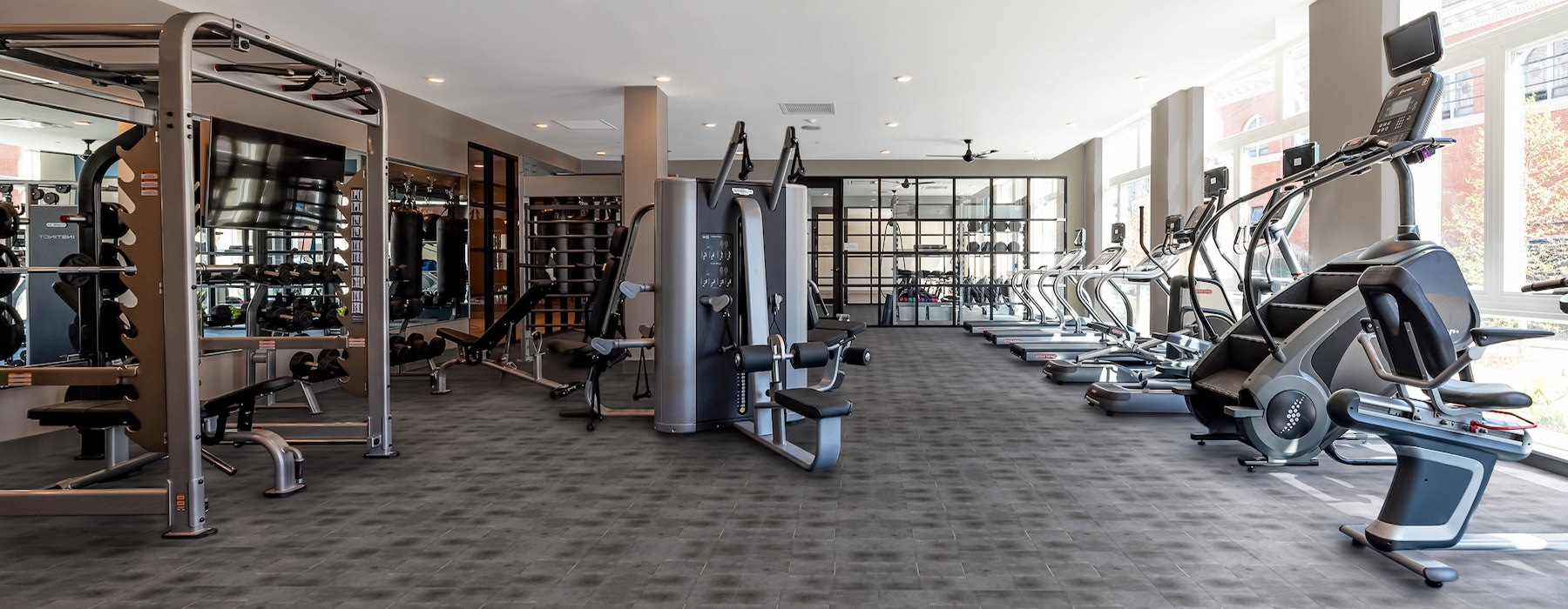 Spacious well lit gym with large windows